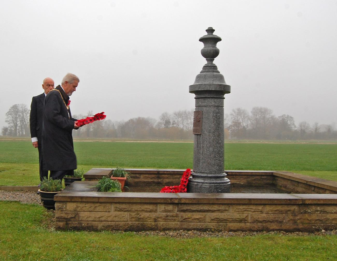 Mayor Graham Perry laying a wreath  at Wolds Gliding Club (Pocklington Airfield) on Rem Sunday 2011 - 102 Ceylon Squadron